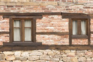 Two windows in an old stone house