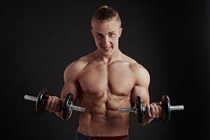 Bodybuilder lifting dumbbells