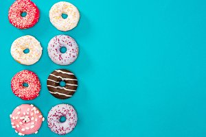 colorful donuts isolated on blue