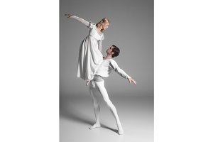 Two young ballet dancers practicing. attractive dancing performers  in white