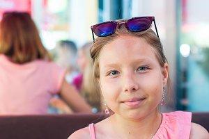 Little girl posing at cafe