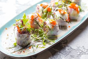 Vegetable spring rolls with caviar.