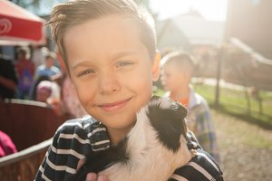 happy smiling boy with cavy