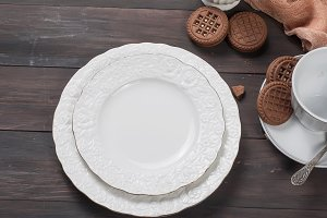white plates with silverware