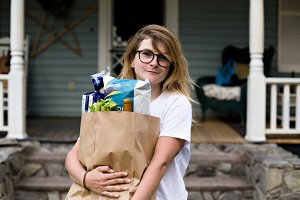 Young woman with groceries bag