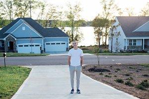 Attractive male walks driveway