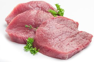 Raw beaf steaks with parsley