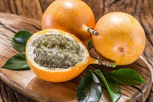 Granadilla fruits on the wooden