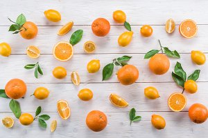 lemons and oranges on the white