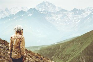 Woman traveler hiking at mountains