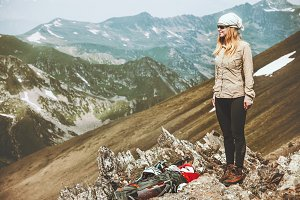 Woman backpacker at mountains