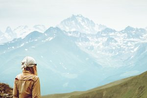 Woman enjoying Caucasus Mountains