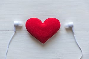 red heart with earphone
