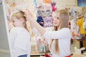 Mother and daughter buying different bows