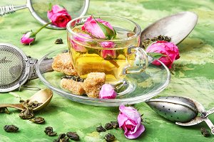 herb tea with tea rose petals