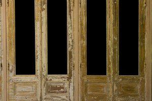 Pair of weathered french wooden doors with isolated windows