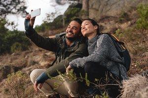 Couple sitting on mountain trail