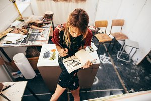 Female artist drawing pictures
