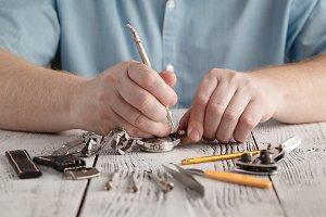 man repair clock