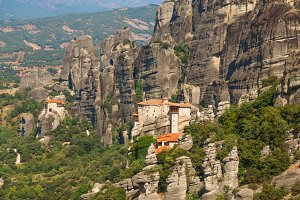 Meteora monasteries. Beautiful view on the Holy Monastery of Great Meteofo placed on the edge of high rock at sunrise, Kastraki, Greece.