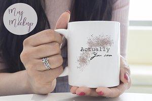 Woman holding mug - mug mockup