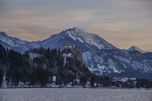 Bled Castle on lake and mountains
