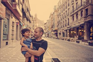Young father in urban scene and baby