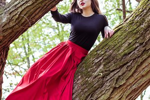 beautiful woman sitting on a trunk