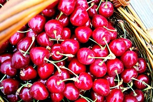 Basket with fresh cherries