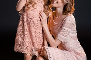 mother and daughter in pink dresses
