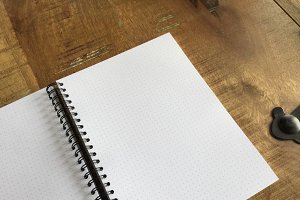 Dot grid notebook on wood table