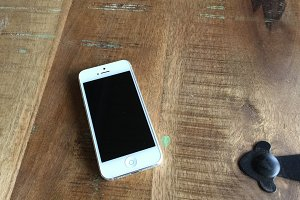 iPhone 5 on wood table