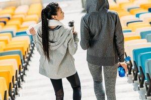 sportswomen on stadium stairs
