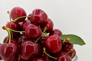 Fresh cherries in glass
