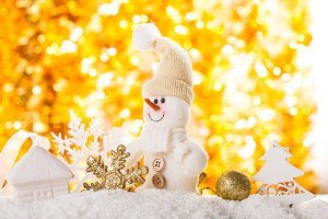 Snowman on gold