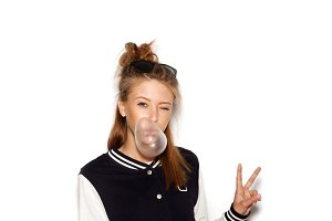 Girl inflating bubble of chewing gum