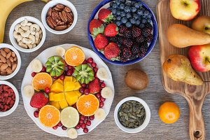 Vegan breakfast: variety of fruits, nuts