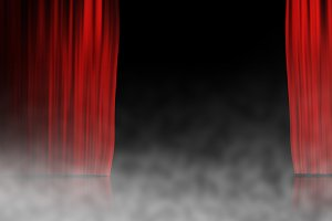 Red stage curtain with smoke