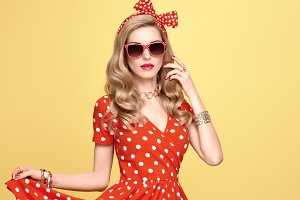 Fashion Blond Girl in Red Polka Dots Dress. Outfit