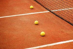 Ball on tennis court background