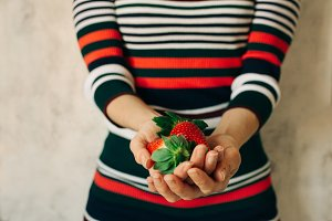 Woman holds strawberries