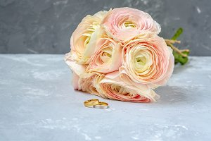 Ranunculus bouquet, wedding rings