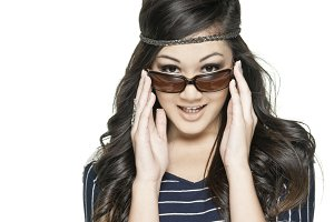 Girl adjusting sunglasses