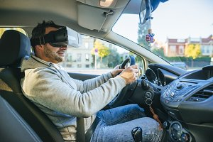 Man in car with VR glasses