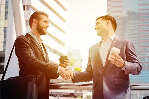 Businessmen handshake with partner