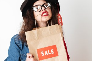 Shopping sale woman showing shopping bag with sale written