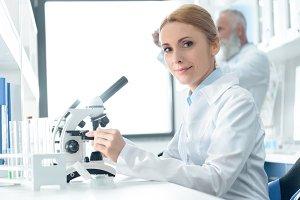 chemist in white coat working