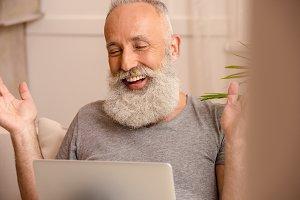 bearded man using laptop