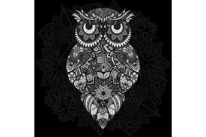Patterned vector owl on the ornamental mandala background. African, indian, totem, tattoo design.   in tribal. doodle isolated black and white