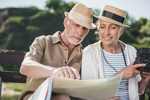senior couple looking at map